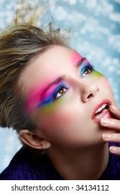Blond woman with pink, purple and green eye make-up