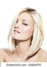 Blond woman with short sleek hair.