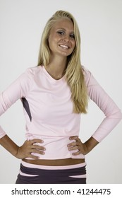 blond woman with a smile and hands on her hips