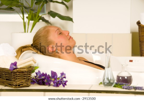 blond woman in a  spa bath relaxing