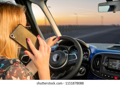 blond woman talking on a cell phone while driving a car