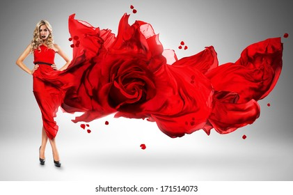 blond woman in windy red rose dress
