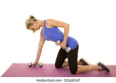 a blond woman working out her arms on her fitness mat.