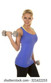 A blond woman working out with her weights, doing arms curls.