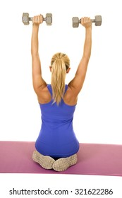 a blond woman working out with her weights, working out her shoulders