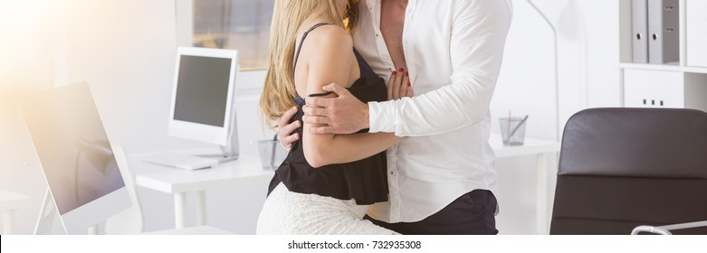 Blond woman with a young man having affair at work