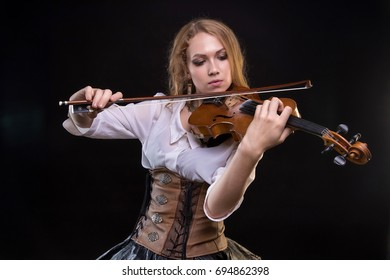 Blond young girl playing the violin