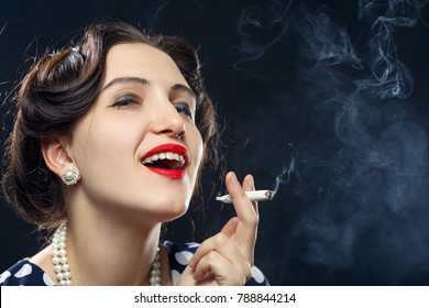 blond young woman smoking joint on black background
