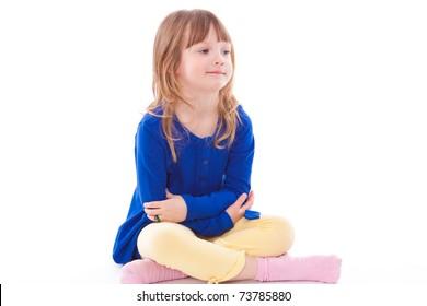 Blonde beautiful smiling little girl sitting