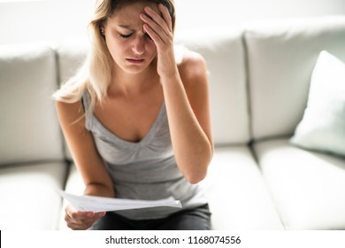 Blonde Beautiful woman stressed because of bills