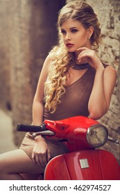 blonde beauty on a scooter