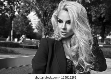 Blonde beauty posing on bench
