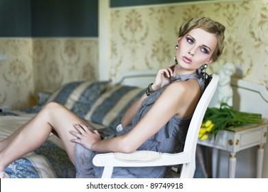 blonde beauty in a vintage room