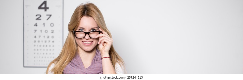 Blonde beauty woman in optician's office - panorama