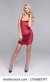 Blonde beauty woman wear red dress