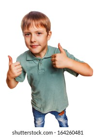 blonde boy kid in blue shirt holding thumbs up, showing the sign yes isolated on white background