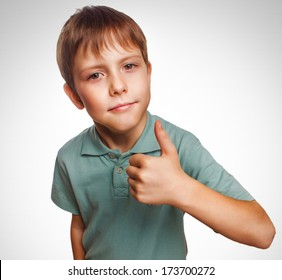 blonde blonde boy kid in blue shirt holding thumbs up, showing sign yes emotion isolated gray largeoy kid in blue shirt holding thumbs up, showing sign yes emotion isolated gray