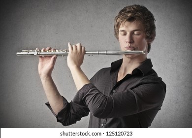 Blonde boy playing a clarinet