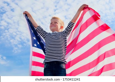 Blonde boy waving national USA flag outdoors over blue sky at summer - american flag, country, patriotism, independence day 4th july