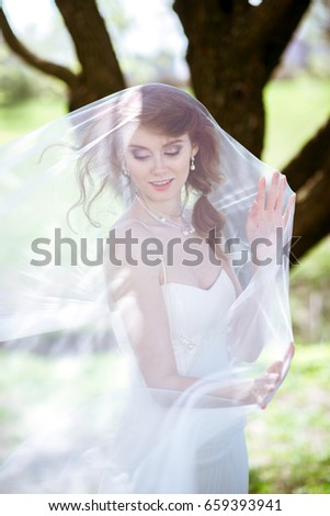 9f53383cf68 Blonde bride in fashion white wedding dress with makeup. Wedding day of  bride in bridal
