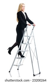 Blonde in a business suit on a step-ladder on a white background