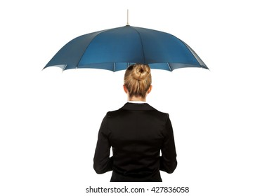 Blonde businesswoman holding an umbrella