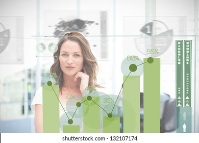 Blonde businesswoman using green chart interface with statistics