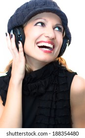 Blonde caucasian girl listening to the music with a pair of headphones