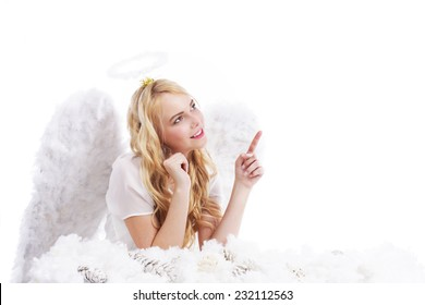 Blonde christmas angel pointing up