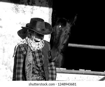 the blonde cowgirl on the farm with the brown horse
