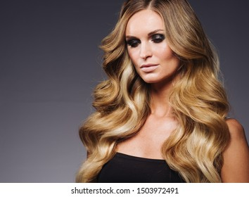 Blonde curly hair woman beauty hairstyle makeup fashion beautiful model