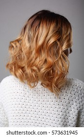 blonde with curly short hair