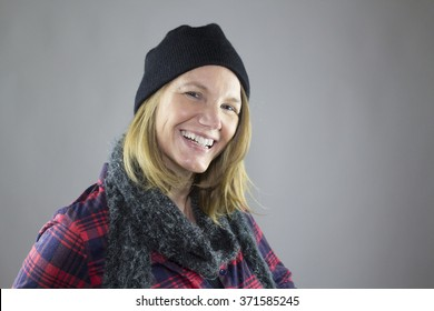 Blonde Female Smiling Wearing Blue Hat