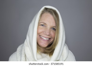 Blonde Female Smiling Wearing White Sweater with Hood