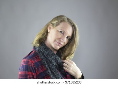 Blonde Female Wearing Blue Scarf and Red Flannel Shirt