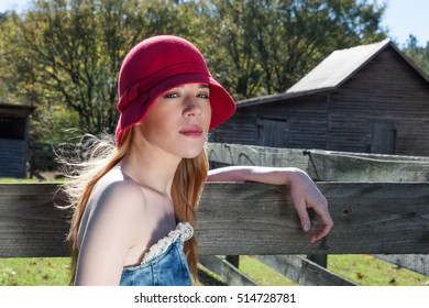 Blonde Female Wearing a Red Hat in Outdoor Shoot on Farm