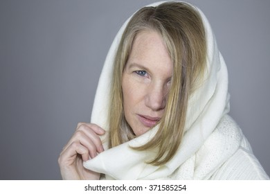 Blonde Female Wearing White Sweater with Hood