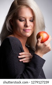 blonde girl with apple