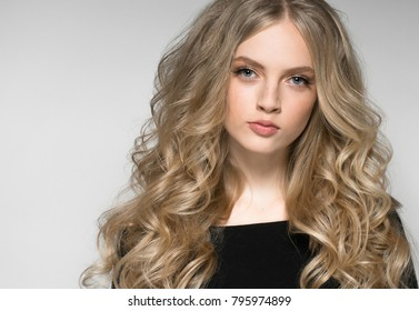 Blonde girl beautiful model long hairstyle and beauty lips