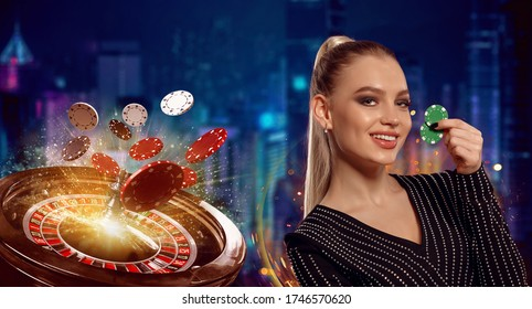 Blonde girl in black dress. Smiling, showing two green chips, posing on colorful background with roulette and flying chips. Poker, casino. Close-up