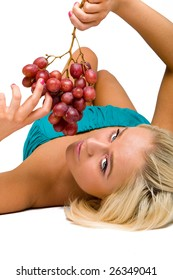 blonde girl in blue with grapes
