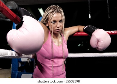 Blonde girl in the corner of a boxing ring