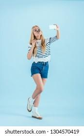 Blonde girls in striped socks something is