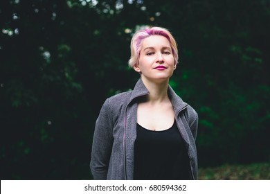 Blonde girl in the forest looking neutral