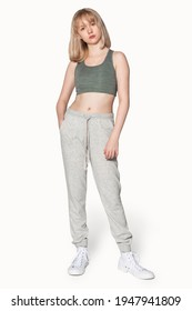 Blonde girl in gray sports bra for activewear photoshoot
