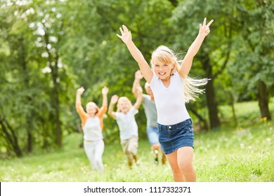 Blonde girl happily cheers on a family outing