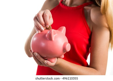 Blonde girl holding a piggybank