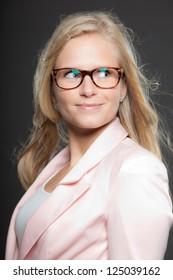 Blonde girl with long hair and glasses. Beauty studio shot.
