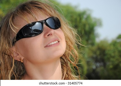 blonde girl looking to the sun on beach