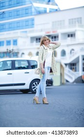 blonde girl with make-up walking around the city